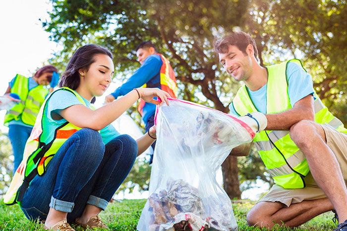 younger adults cleaning up trash