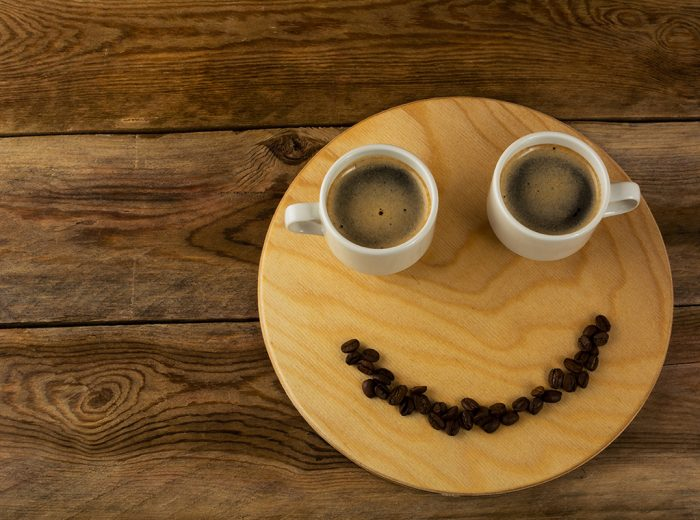 smiley face with coffee beans and mugs