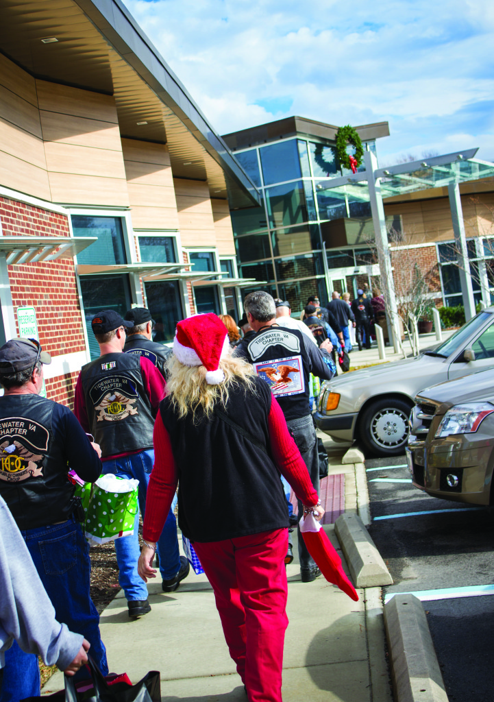 Participants Enter Lake Taylor Transitional Care Hospital's New Beechwood Wing Bearing Gifts