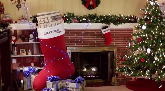 Huge twenty dollar bill in christmas stocking